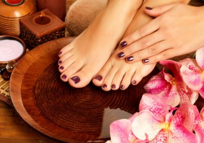 closeup-photo-female-feet-spa-salon-pedicure-procedure-female-legs-water-decoration-flowers_186202-4352