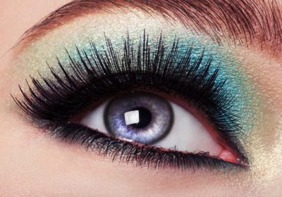 woman-s-eye-with-green-eye-make-up_186202-6911
